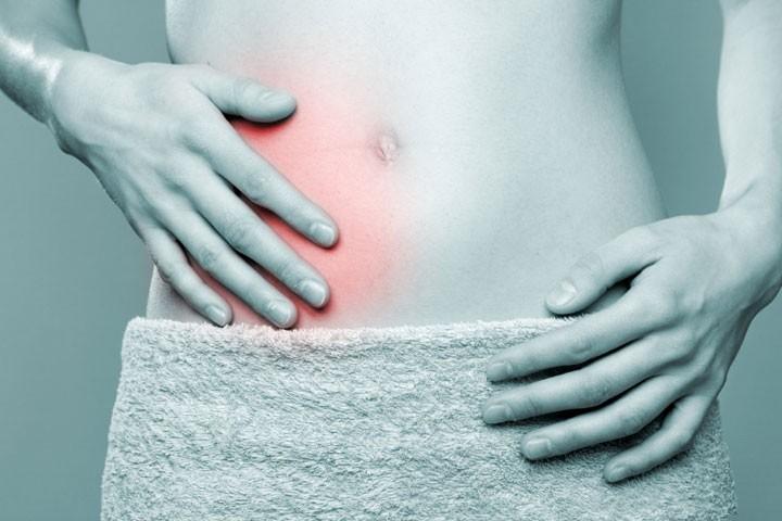 цистит боль в правом боку и вздутие живота